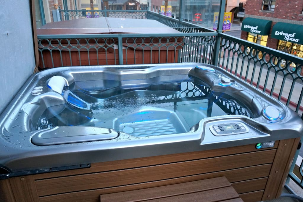 Brand new private hot tub on the balcony overlooking the mountain town.