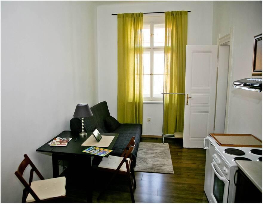 Room with kitchen corner. Double sofa