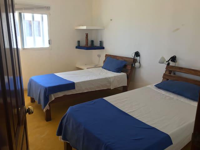 1st floor bedroom (three individual beds)
