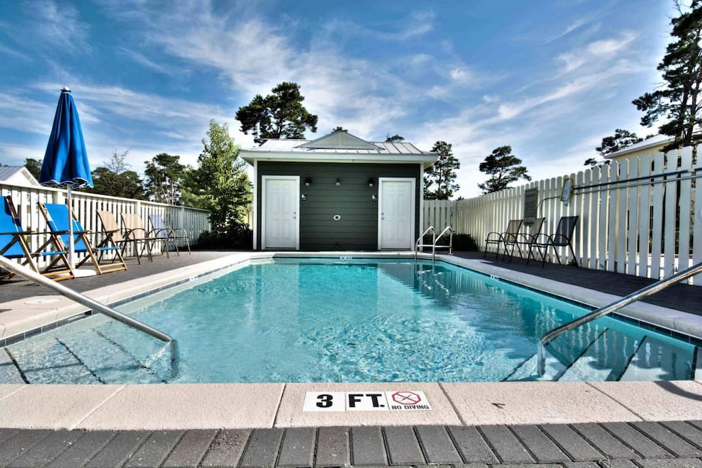 Relax by the beautiful community pool, located just a short walk from the house