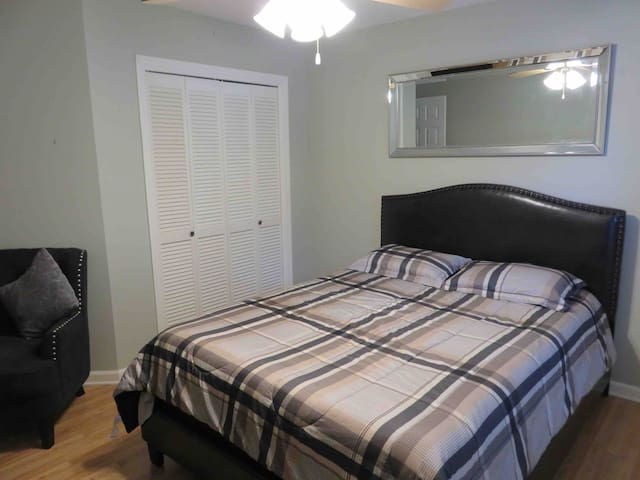 The Guest Bedroom! Contains a comfy queen sized mattress and bed frame.