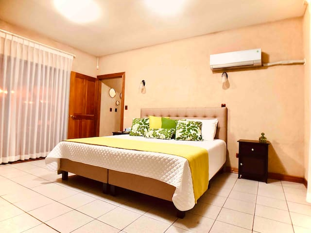 Main bedroom has a King Bed, a large walk in closet and its own bathroom. A large slider door overlooks the pool area which you can enjoy while laying in bed.