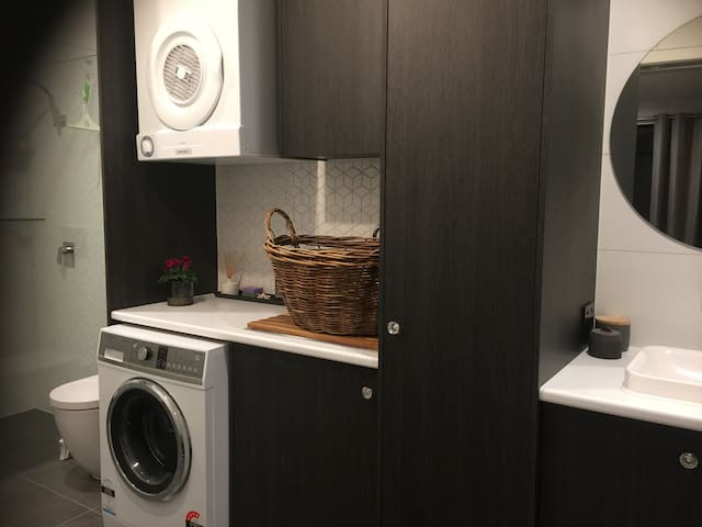 A newly renovated spacious en-suite/laundry combined.  Fisher & Paykel washing machine and dryer for your convenience during your stay.