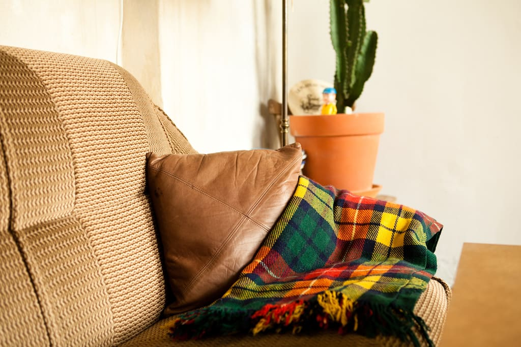 comfortable sleeper sofa, extra bedding below