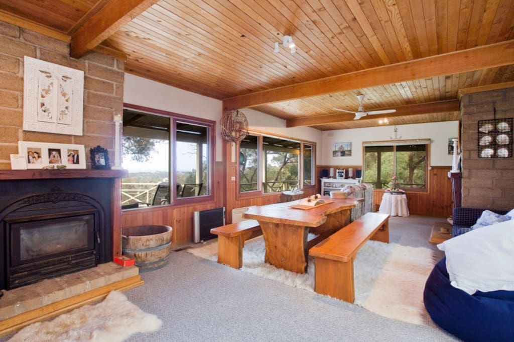 Log fire place, massive dining table... All you need now is great company and good food!