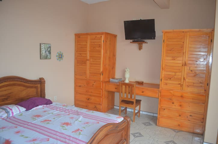 Each first floor bedroom has a TV and DVD player, a desk, two closets, a chair, a sofa,  matrimonial bed and a single bed.