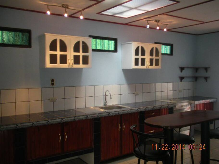 Large kitchen, designer tile, bar