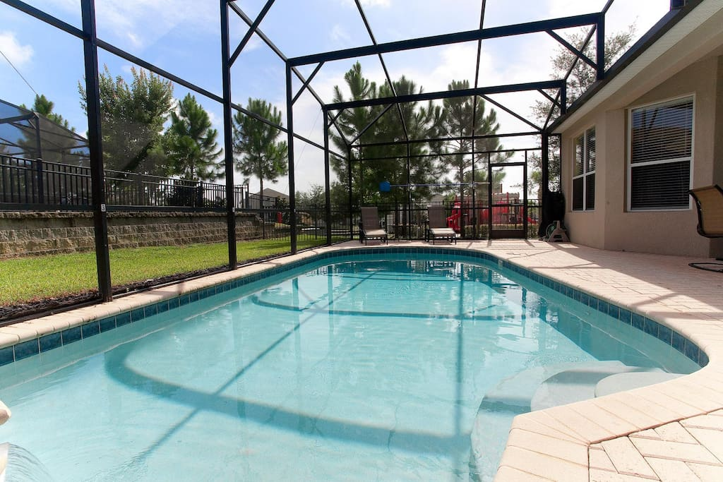 The pool area is large and inviting, has a child safety fence and is next to the deluxe community playground