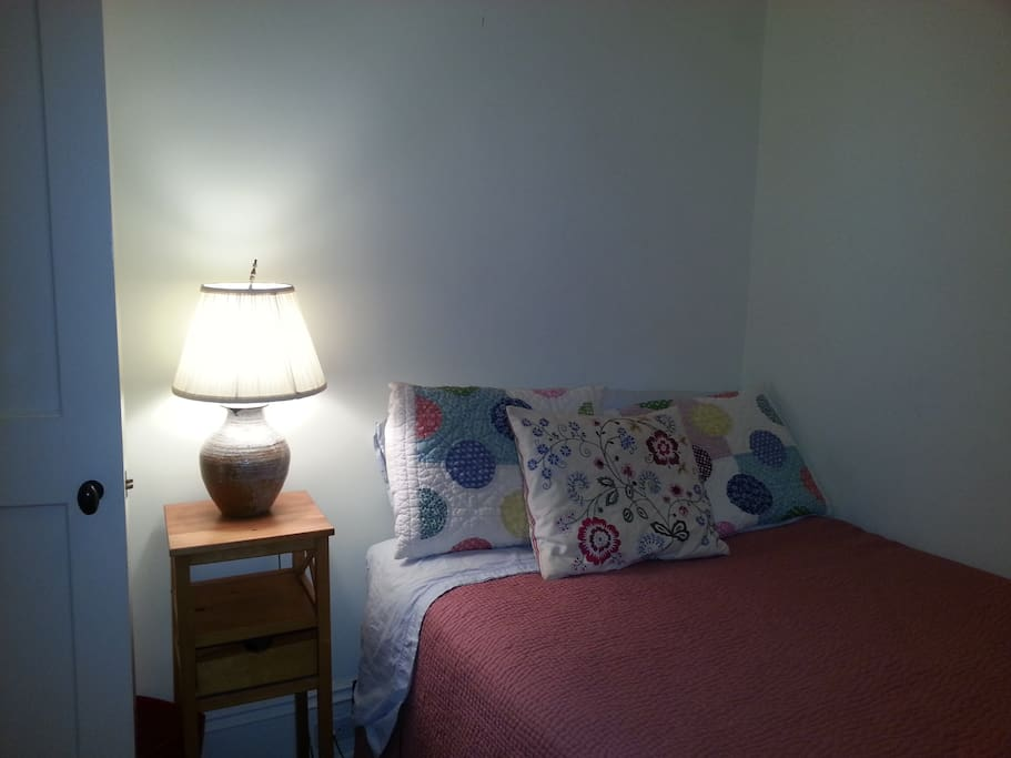 Quiet, interior bedroom with double bed, closet space. air conditioning.