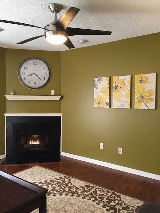 Warm and comfortable living room with gas fireplace.