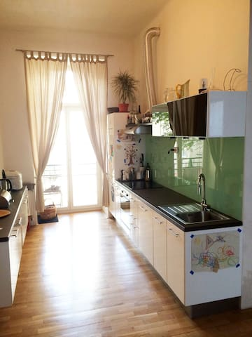 Fully equipped kitchen with door to balcony