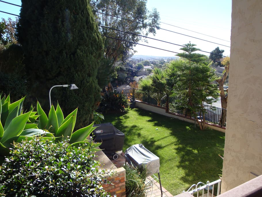 Back Yard with BBQ area and view over Sea World