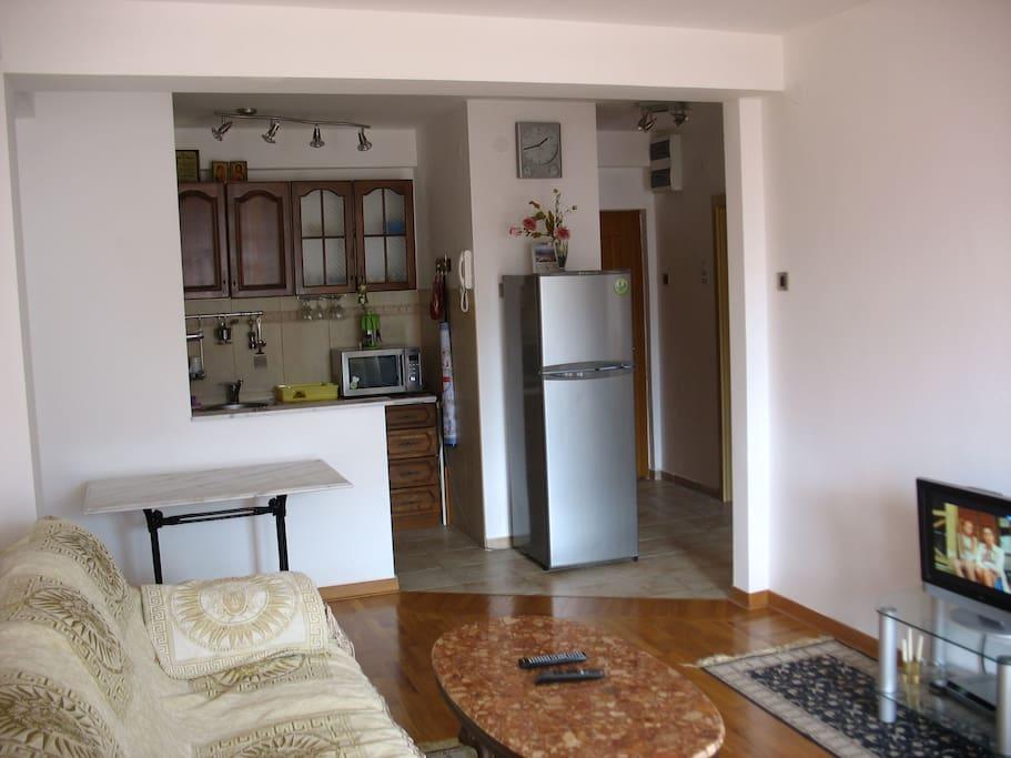 Stylish open-plan kitchen-dining room ( air conditioner, fridge-freezer, microwave)