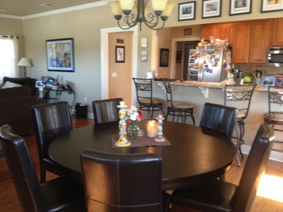 Dining table open to kitchen and living room.