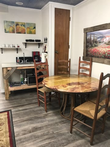 Coffee bar and onyx table with chairs.