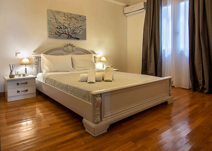 The classy and comfy double bed in the bedroom with A/C.