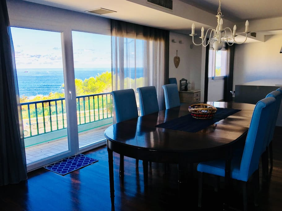 Spacious Dining area enjoying endless sea views, with access to the front terrace. Possible to seat 8 people.