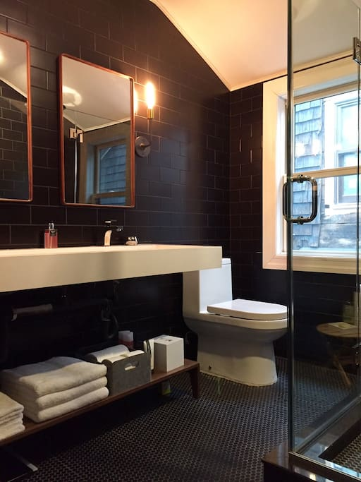 Private bath with double vanity, standing shower and toilet