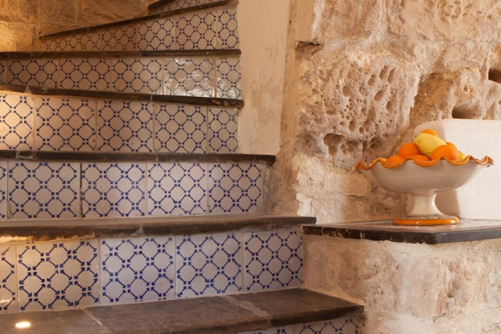 Floor-lit staircase with traditional Sicilian tiles
