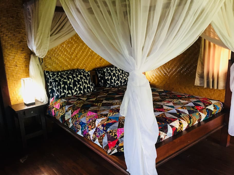 comfortable bedroom with mosquito net