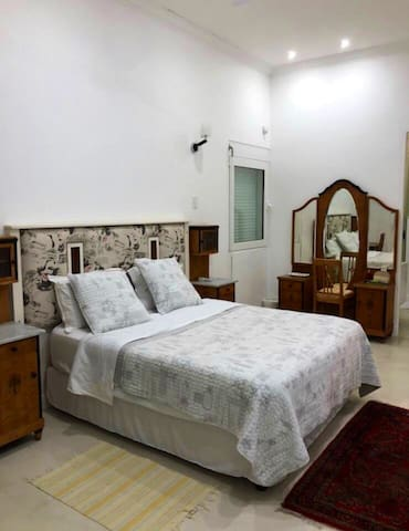 This is the master bedroom with a queen size mattress. It has an en suite bathroom.