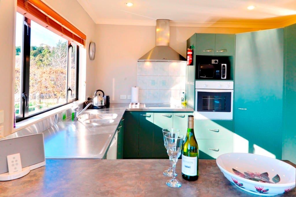 Modern kitchen with dishwasher, fridge/freezer.