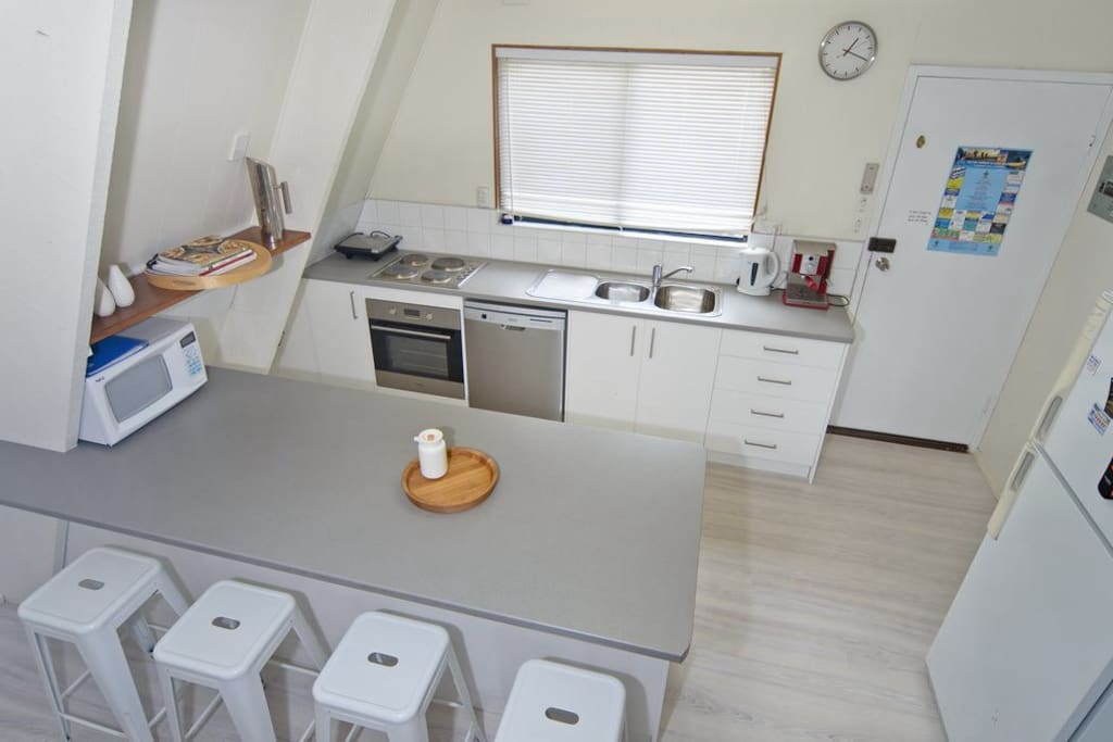 Brand new kitchen with dishwasher and coffee machine, popcorn and milkshake makers, toaster, grill, microwave, plenty of glasses, plates for a great dinner party.
