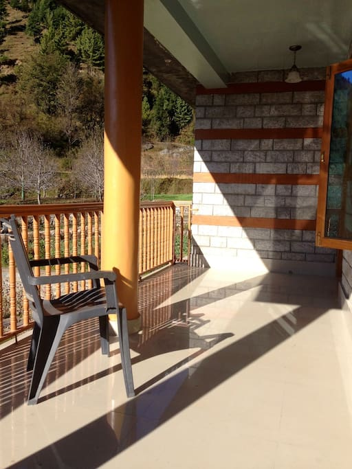 Big balcony with a view of apple trees and the mountain. There is plenty of sun to enjoy the warmth of it.
