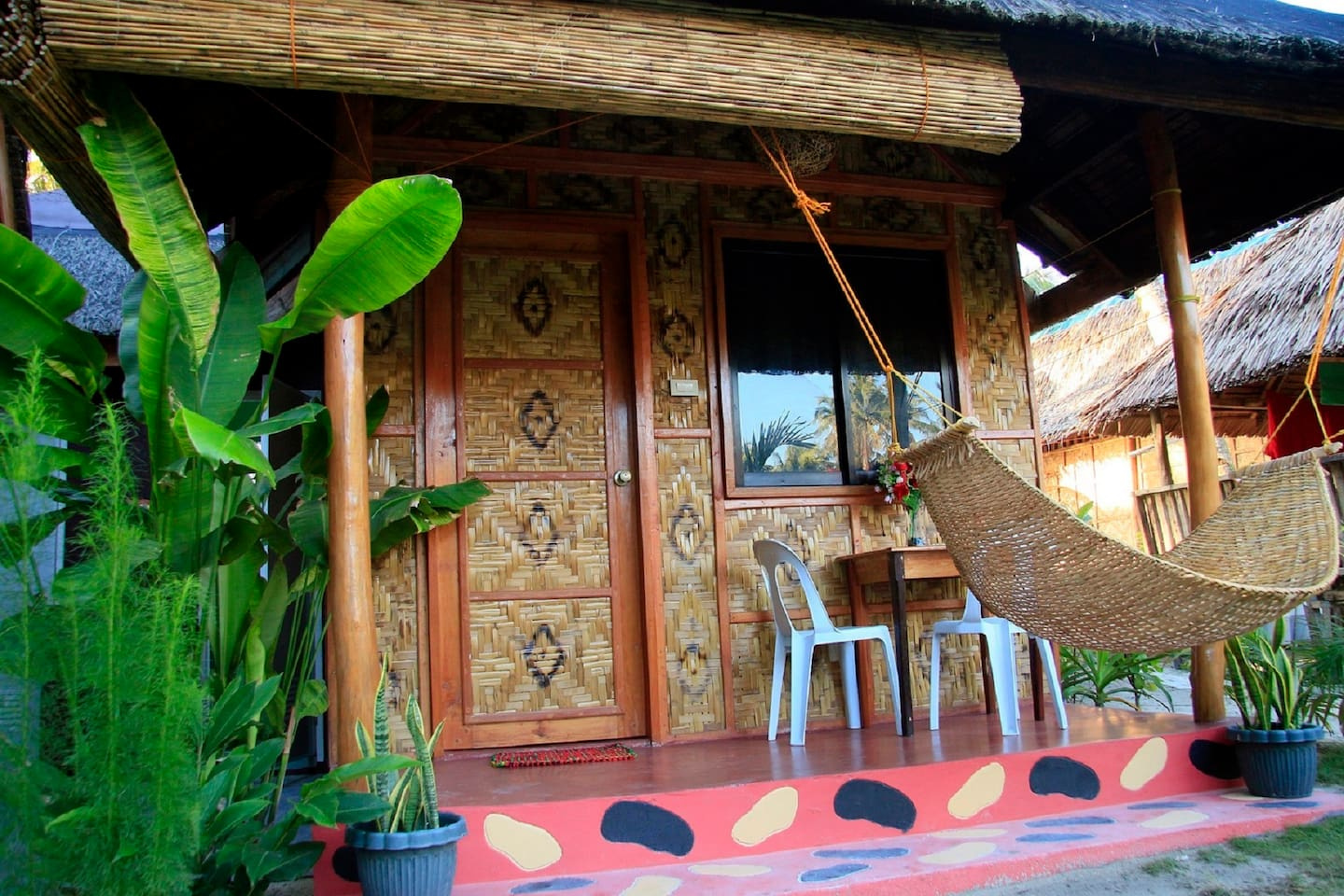 Front view from the Bungalow BEE 2 with is own terrace and hammock