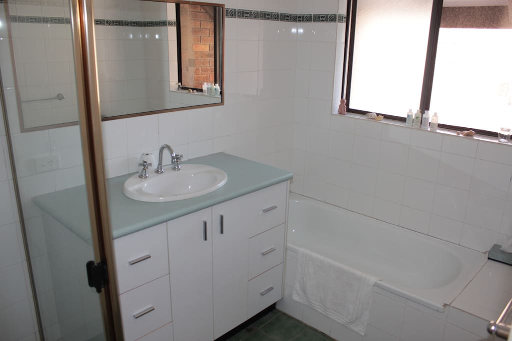 Bathroom with two way access, hair dryer & personal amenities. 2 separate toilets.