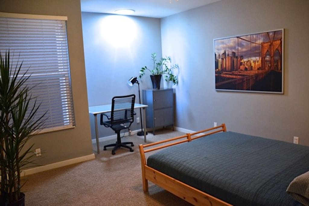 Private Master Bedroom with desk and chair
