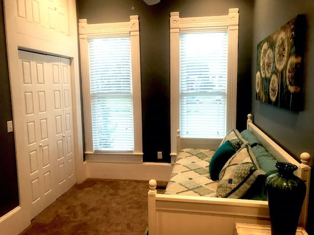Bedroom number two has nice large windows that overlook Historic Central Avenue!