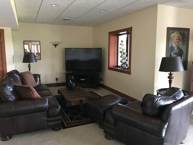 "Lower level rec room corner w 65"" TV"