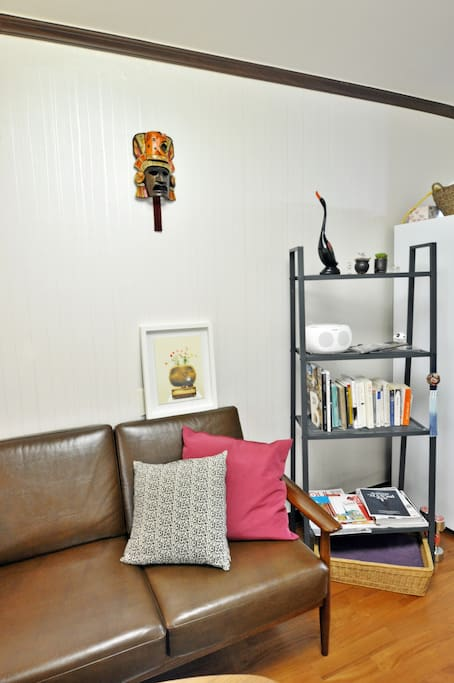 Mini Library with a brown comfy sofa