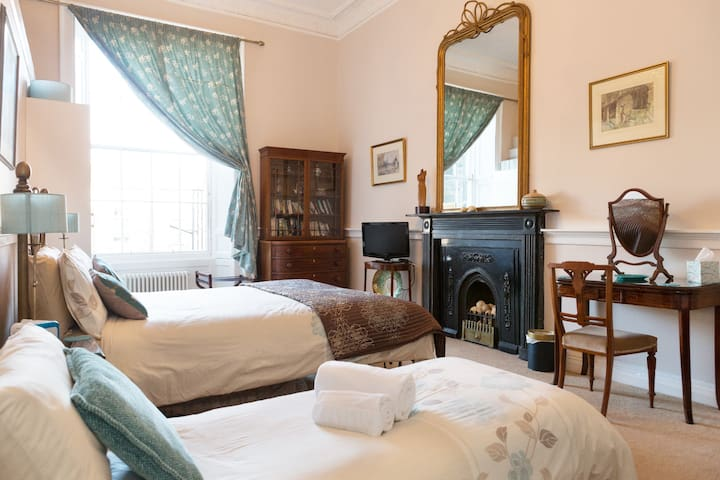 Bedroom 1 has a queen size bed and its original marble fireplace.