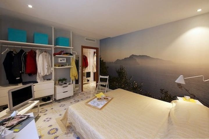 Bedroom with large double bed, TV set, safe, sound-proof window.
