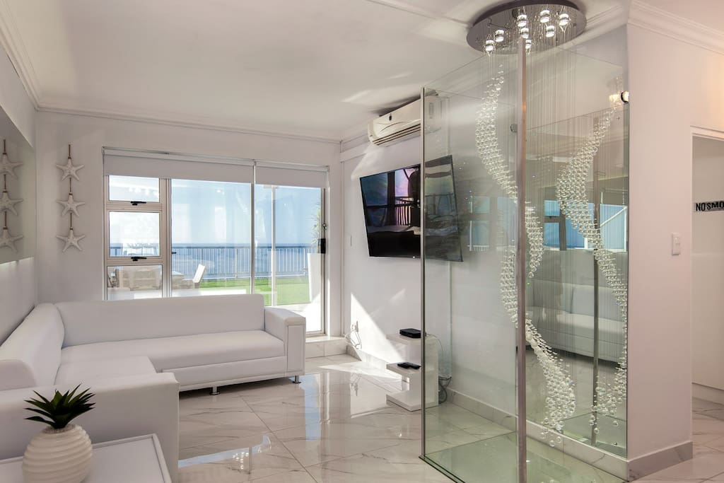 Exquisite views from living room which opens onto private patio. 65 inch curved tv