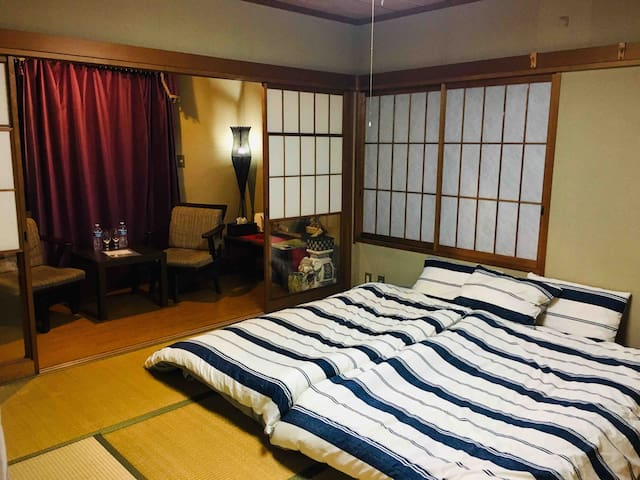 Resplendent large traditional Japanese style room. It's why you came to Japan:)