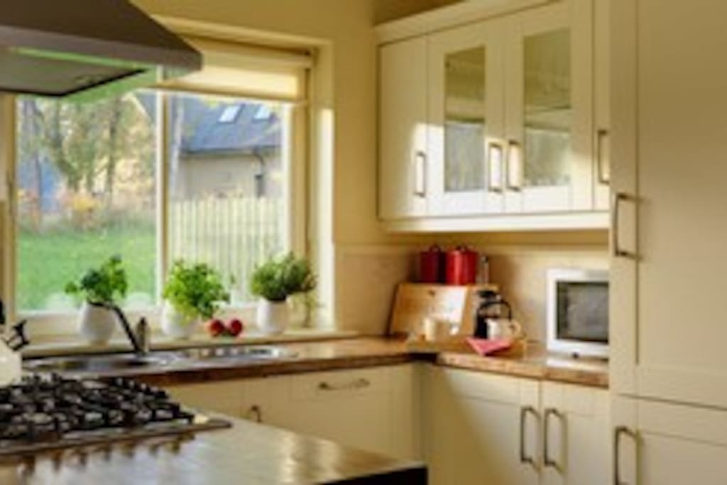Bright kitchen with all mod cons; Separate utility room