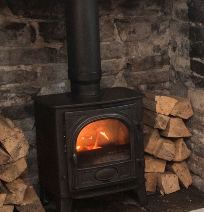 Wood burner in both cottages