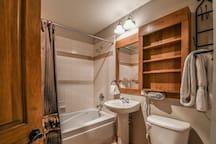Bathroom with one sink plenty of storage and shower/bath