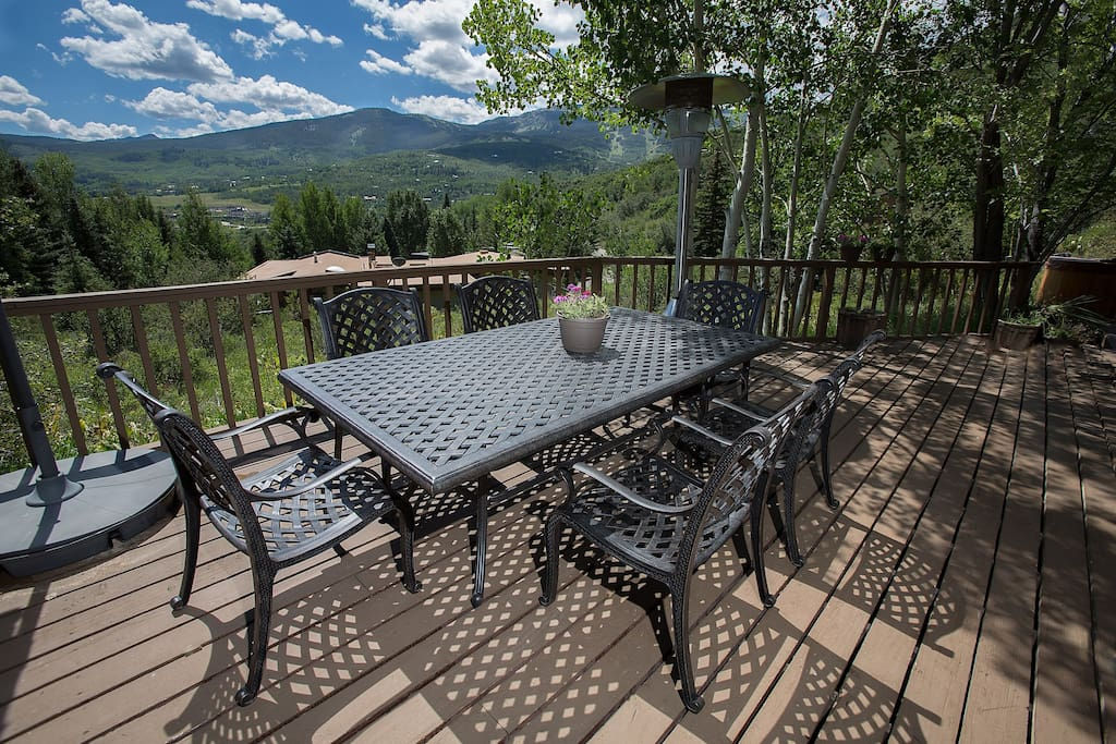 Deck with table, chairs, grill, hot tub and fabulous view.