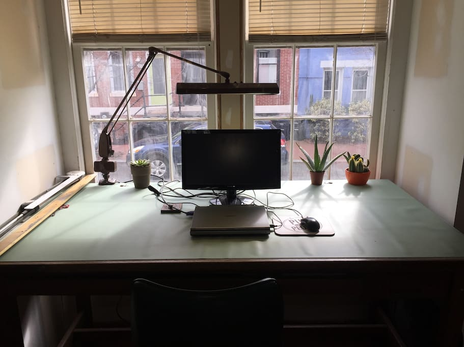 Bay window drafting table.  Laptop will be here for your use.