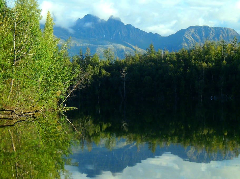 Pristine Canoe Lake stocked with fish surrounded by mountains.