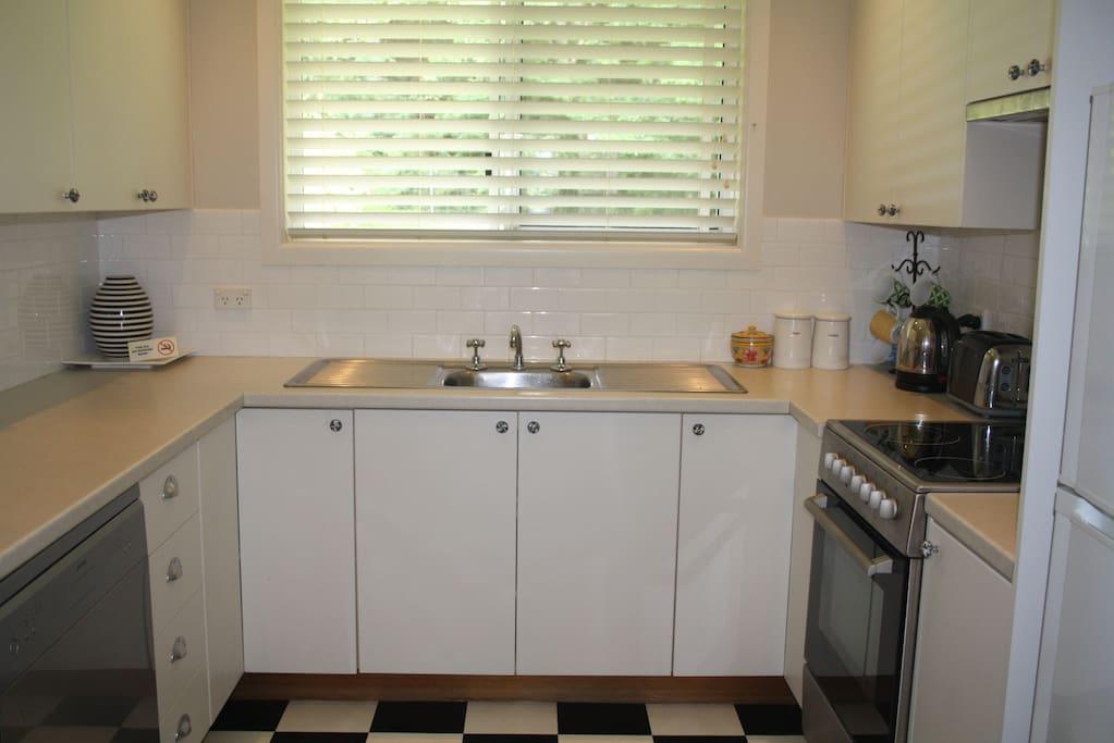 Dishwasher & electric stove. Microwave and fridge.
