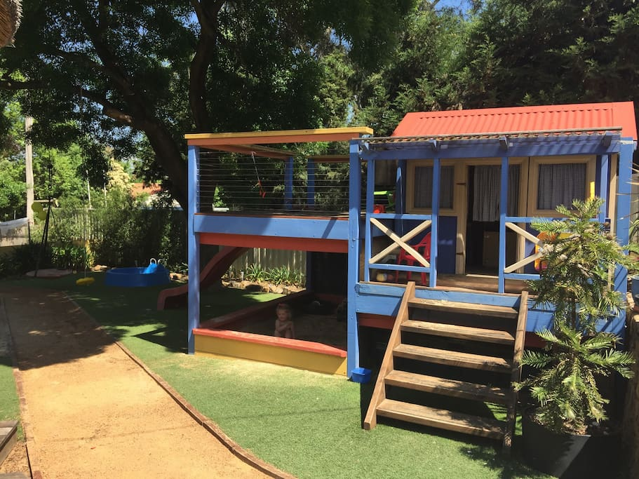 Cubby house with own deck and slide, plus sandpit underneath !