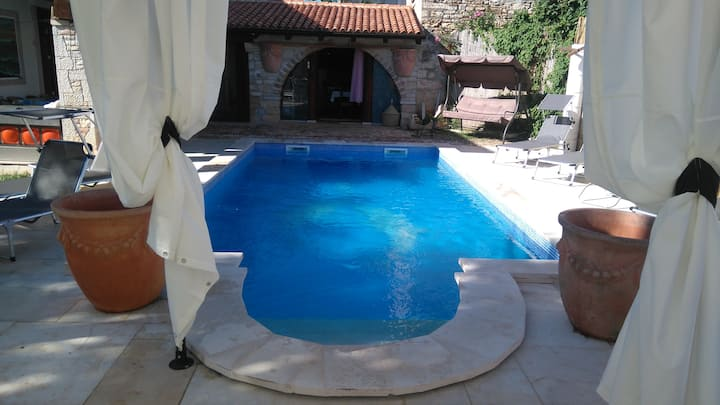 Spacious holiday apartment with big garden & private pool