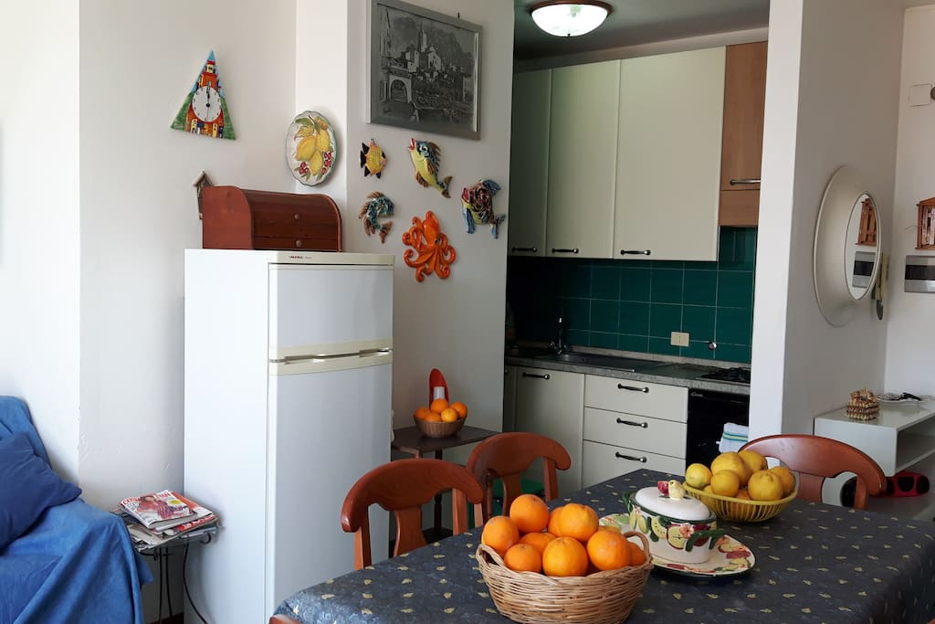 Living room with kitchen, oranges and lemons of my  garden :)
