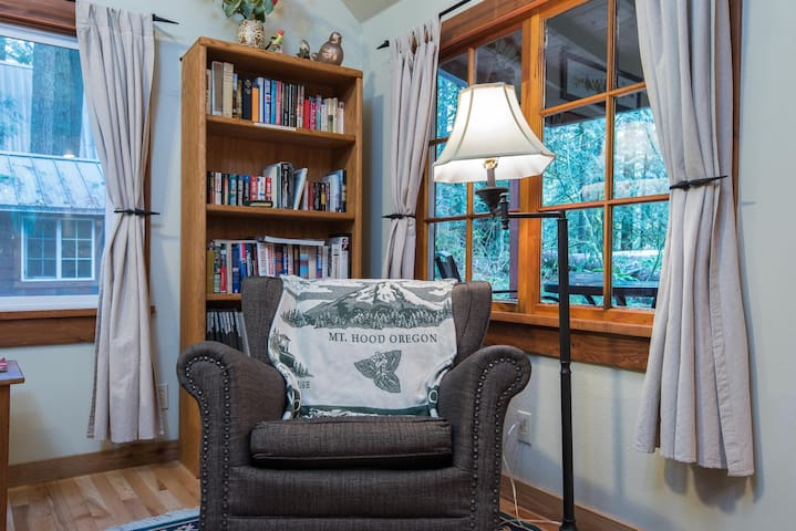 Cozy reading area with lots of books and games