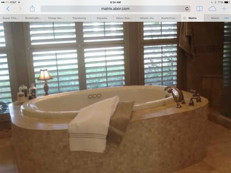 Master bath with jacuzzi tub, shower, two sinks